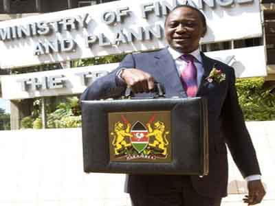 Kenyan Finance Minister Uhuru Kenyatta holds up a briefcase containing Government Budget for the year 2009/2010 in Nairobi